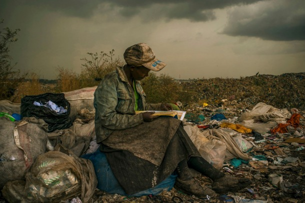 Micah Albert of the U.S., has won the first prize in the Contemporary Issues Single category of the World Press Photo Contest 2013with this picture of a woman pausing in the rain as she works as a trash picker at a 30-acre dump in Nairobi